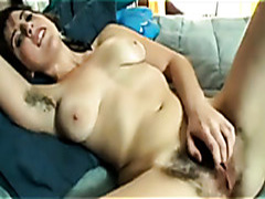 Tattooed girl with hairy cunt masturbates her clit