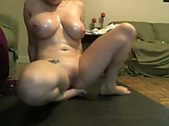 Oiled up curvy webcam girl fucks her cunt with a toy