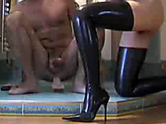 Wife jerks him off as he rides a thick dildo