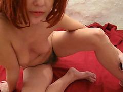 Redhead with a big bush cums on her dildo