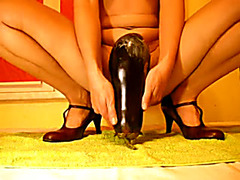 Lubed amateur cunt rides huge eggplant and stretches