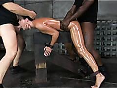 Sub slut in bondage spit roasted by hard dicks