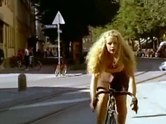 Blonde has an orgasm riding her bike through the streets