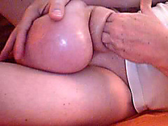 Guy plays with his swollen dick and balls