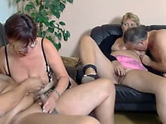 German mature swingers get oral at a hot party