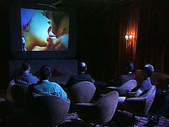 Orgy sex in an adult movie theater