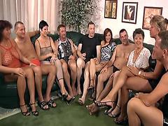 Slutty mature ladies suck dicks in German swinger orgy