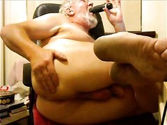 sexy bearded granddad playing with toys