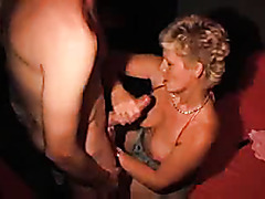 Adult bookstore gangbang of a mature blonde whore