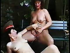 Mature lesbians piss on each other in outdoor video