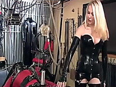 Submissive man getting humiliated by a latex mistress
