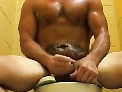 Hunk Jerks and Cums in Public Restroom