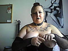 Kinky fat lady ties up her breasts