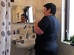 Chubby mature takes a shower and masturbates when all wet