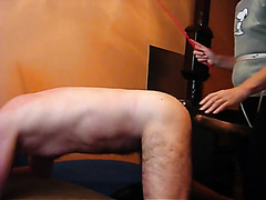 My dominatrix's strapon fucks me from behind