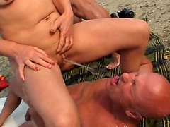 Mature swinger pisses on her husband in outdoor video