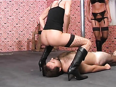 Hot mistresses in leather boots piss in his submissive mouth