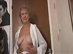 Granny teases her pussy in a white thong