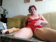 Kinky granny on webcam destroys asshole with a toy