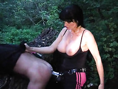 Mistress fucks him with huge strapon outdoors