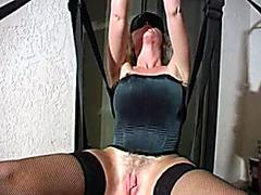Guys take turns fucking beautiful milf in sex swing