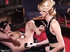 Mistress roughly toys the asshole of her slave