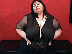 BBW gropes her huge tits in solo show