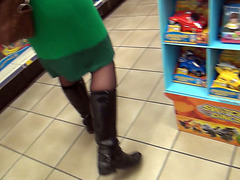 German babe in boots and stockings peeing in a store