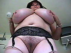 Big mommy shakes her huge tits on camera