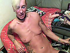 Mature chick pukes on her stomach and fists her vagina