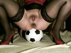 Amateur woman defecates on a soccer ball