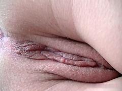 Asshole slowly shitting in close up