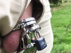 Walking outdoors with a steel chastity