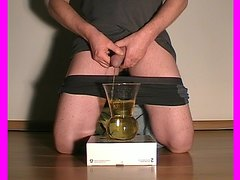 Man pissing and cumming in a glass. Men male peeing piss pee golden shower