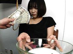 Sweet Asian girl making her own dinner