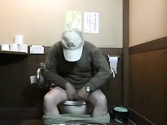 Asian grandpa at the toilet