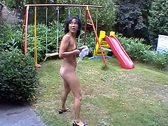 Skinny Asian milf goes pee in the grass