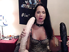 Webcam lady in lingerie fucks huge dildos