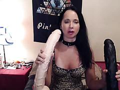 Webcam lady in lingerie fucks huge dildos