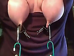 Tit torture video with weights swinging from her tits