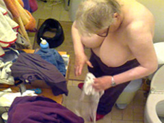 Fat granny gets dressed in hidden cam footage