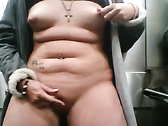Curvy woman masturbates in the elevator