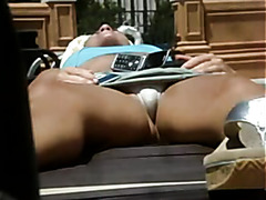 Upskirt footage of cute chick tanning outdoors