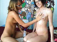 Skinny girls in glasses oil up in webcam porn