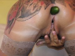 TattooedMILF. AssFucks Herself With Cucumbers