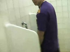blond guy walks to toilet for a piss