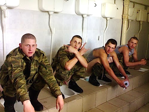 COMRADERY: Military Men Shitting Together