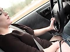 Brunette girlfriend masturbates her cunt while driving