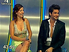 Busty lady on Latin TV show has great cleavage