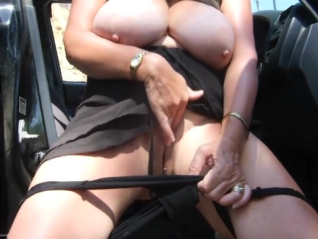 Chubby wife rubs her wet pussy in the car